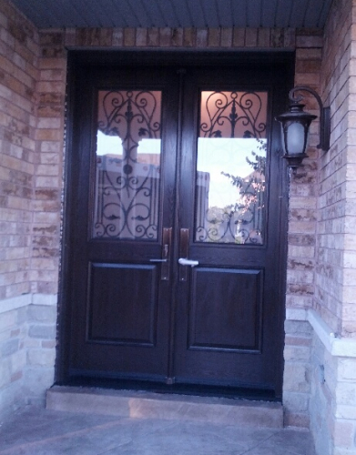 Fiberglass Doors-Wrought Iron Fiberglass Doors with multi point locks installed in Richmond Hill by windowsanddoorstoronto.ca