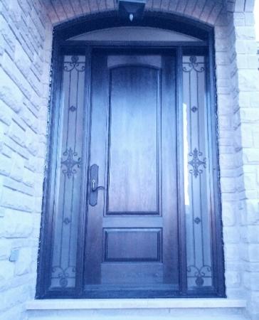 Windows and Doors Toronto-Custom Front Doors-Custom Fiberglass Doors-Front Entry Custom Fiberglass Door with Custom Wrought Iron Side Lites & Transom installed in Toronto by windowsanddoorstoronto.ca