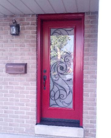 Windows and Doors Toronto-Wrought Iron Woodgrain Doors-Front Single Entry Door with Wrought Iron Design installed in Brampton by windowsanddoorstoronto.ca