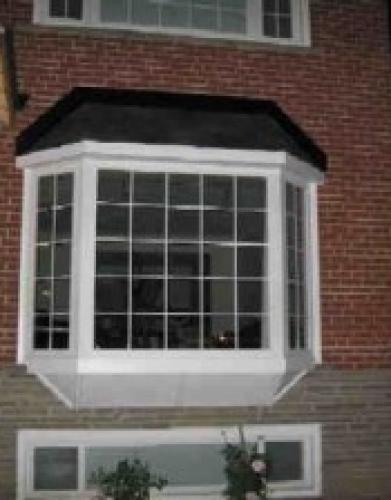 Installation of Bay Window Basement Windows in Toronto by Windows and Doors Toronto