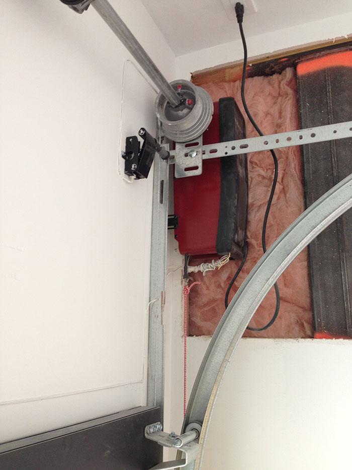 Installation of a Garage Door with a Side Motor in custom house in Oakville by Modern Doors