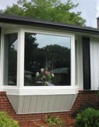 Installation of oversized bay Window with vinyl siding by Windows and Doors Toronto