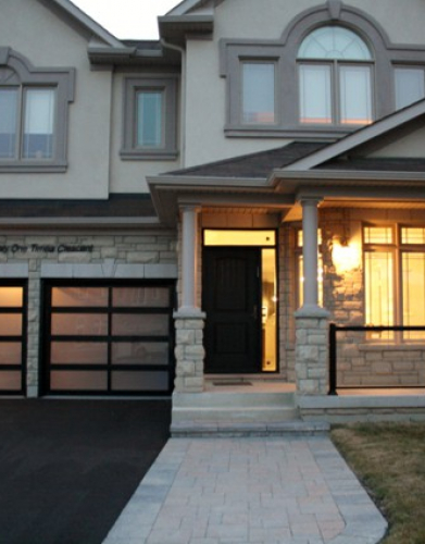 Windows and Doors Toronto-Modern Aluminum Glass Garage Doors installed by Windows and Doors Toronto in Oakville