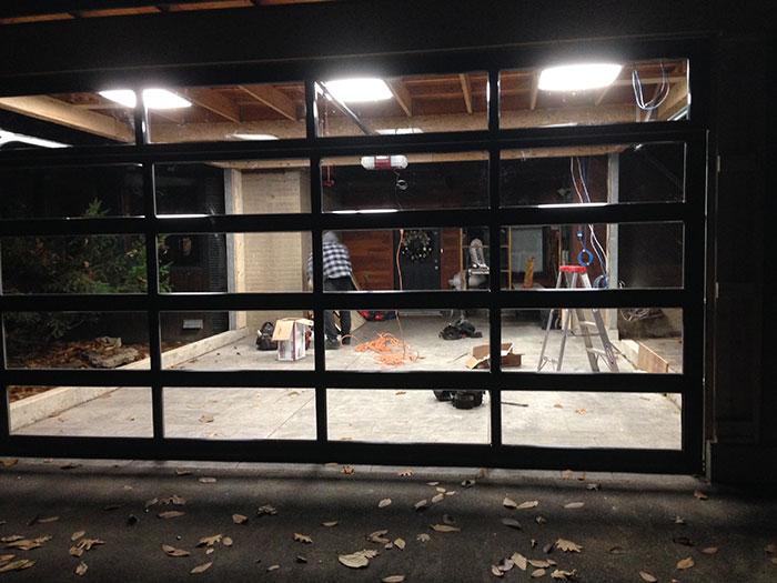 Oversized Aluminum Glass Garage Door During Installation in Custom Home in Oakville by windows and doors toronto