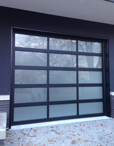 Oversized Aluminum Glass Garage Door in Custom Home in Oakville by windows and doors toronto