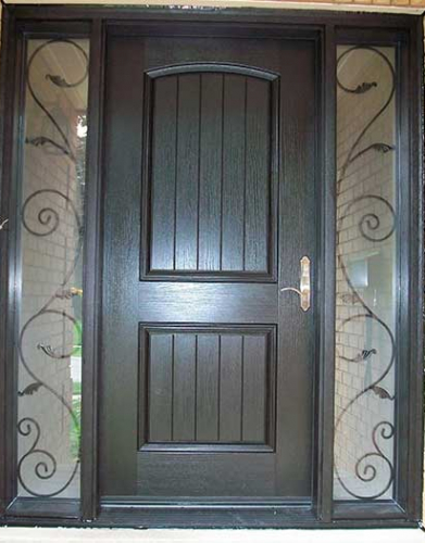 Windows and Dooors Toronto-Rustic Doors-Fiberglass Rustic Doors-Rustic Door Woodgrain Fiberglass front Single Door with 2 Iron Art Design installed  by Windows and Doors Toronto
