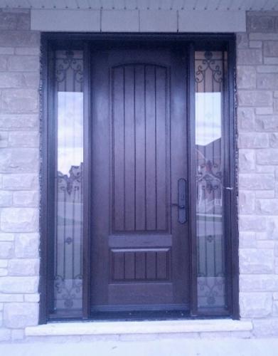 Windows and Doors Toronto-Rustic Doors-Fiberglass Rustic Doors-Rustic Fiberglass Door with 2 Wrought Iron Side Lites installed by windowsanddoorstoronto.ca in Richmond Hill
