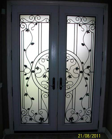 Windows and Doors Toronto-Smooth Fiberglass Doors-Smooth Doors- Wrought Iron Smooth Doors with Multi Point Locks Installed  by Windows and Doors Toronto