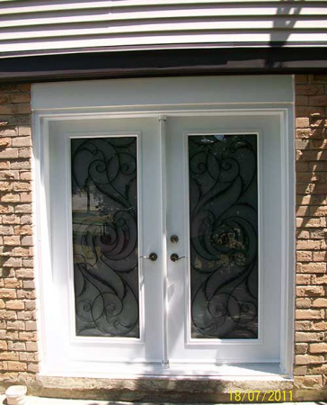 Windows and Doors Toronto-Smooth Fiberglass Doors-Smooth Doors-White Jullietta Smooth Doors with Multi Points locks installed by  Windows and Doors Toronto