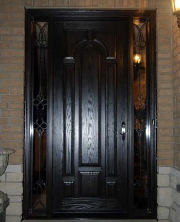 Woodgrain doors-Front Entry Doors-Wood grain Front Door With 2 Side Iron Art Lites Installed by windows and doors Toronto in Barrie Ontario