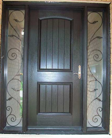 Woodgrain Exterior Doors-Woodgrain doors-Front Entry Doors-Wood grain Rustic Fiberglass front Single Door with 2 Iron Art Design installed by windows and doors Toronto