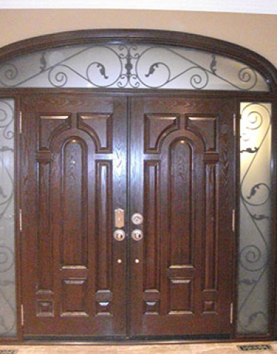 Front Entry Doors-Wrought Iron Doors, Parliament Design Doors with 2 Iron Arts Side Lites and Transom, Inside View installed by Windows and Doors Toronto in Richmond Hill