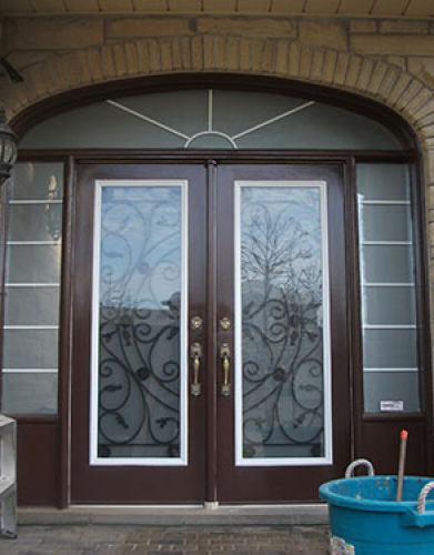 Front Entry Doors-Wrought Iron Double Doors-Fiberglass Doors Julietta Design with 2 Side Lites and Transom, Outside View Installed by Windows and Doors Toronto in Richmond Hill