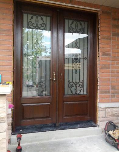 Windows and Doors Toronto-Wrought Iron Fiberglass Double Doors-Front doors Mahogany with Multi Point Locks Installed By Windows and Doors Toronto in Oshawa