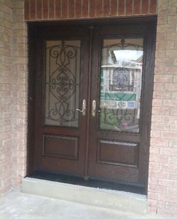 Windows and Doors Toronto-Wrought Iron Woodgrain Doors-Fiberglass Double Doors Installed by Windows and Doors Toronto in Thornhill