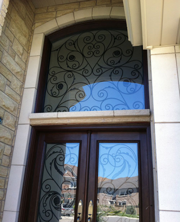 Windows and Doors Toronto-Wrought Iron Woodgrain Doors-Fiberglass Doors with Iron Art Transom Installed in Richmond Hill by Windows and Doors Toronto